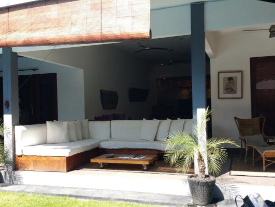 Premium Villas Seminyak: sitting area in front of the pool