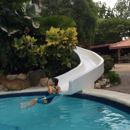 Swimming pool with slide picture of costabella tropical - Hotels in cebu with swimming pool ...