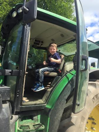Bolton, UK: Excited boy at the front of the tractor