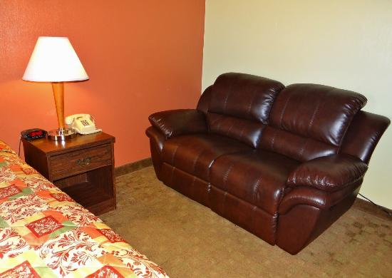 Weathervane Motor Court: New leather loveseat recliner in our single King bed room.