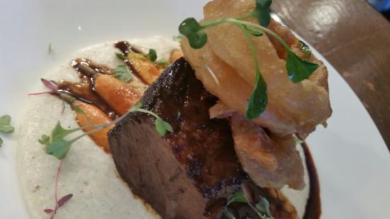 Solstice : Apple cider braised short rib over stone ground white grits with cheddar with crispy IPA battere