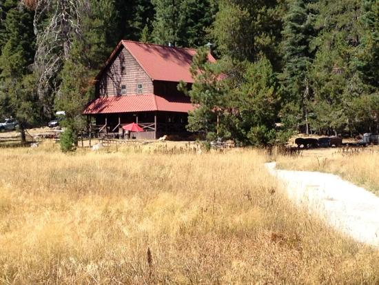 Drakesbad Guest Ranch: View of the main lodge from the meadow.