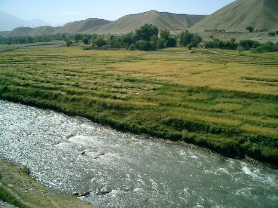 Faizabad, Afghanistan: Running stream beside a green field