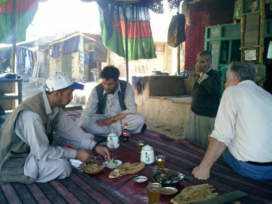 Faizabad, Afghanistan: Sharing a meal at a roadside cafe