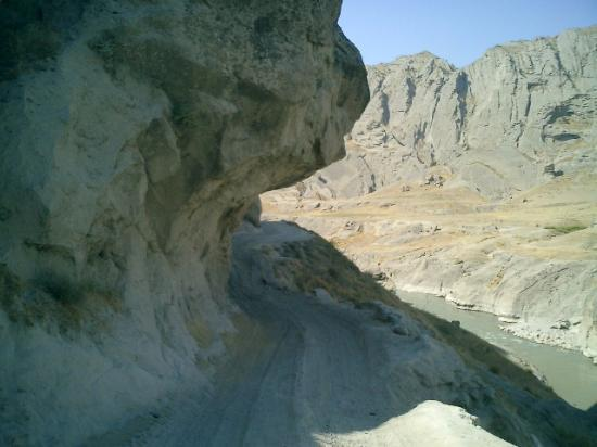 Faizabad, Afghanistan: Winding road cuts through a soft cliff