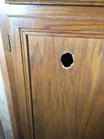 The Islander Motel: holes in cabinets