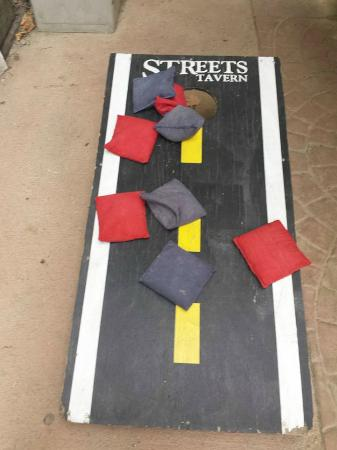Streets Tavern Bar And Grill: Corn Hole On The Patio