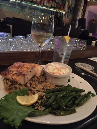 Παραλία Ocean Isle, Βόρεια Καρολίνα: Surf and Turf! Parmesan Encrusted Striped Bass over rice and Rib Eye with a baked potato. Excell