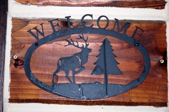 Columbia Falls, MT: Welcome sign on the porch
