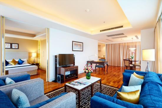 Natural Ville Executive Residences: Spacious Living Area & Comfortable Bedroom-Deluxe One-Bedroom Apartment