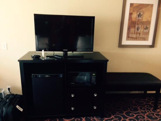 Hampton Inn & Suites Dickinson : TV on top of cabinets with microwave and mini-fridge