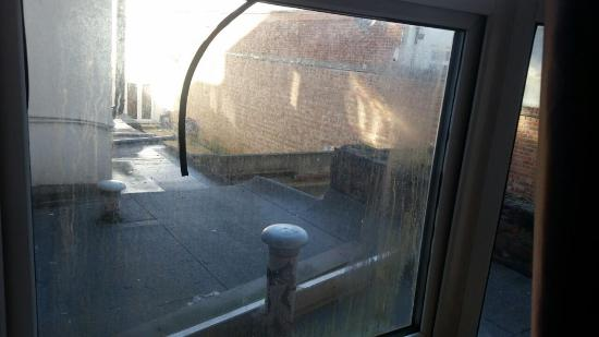 Pasha Hotel: view from window and draughty broken window