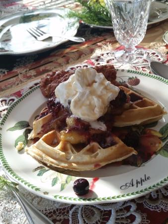 The Pine & Picket B&B: Waffles with bananas foster, freshly whipped cream, berry compote and maple syrup