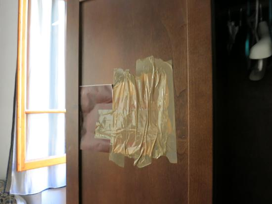 Hotel Medici: inside front door of armoire repaired with duct tape