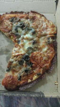 Jefferson, IA: All the extra cheese I ordered was burnt on the edges.