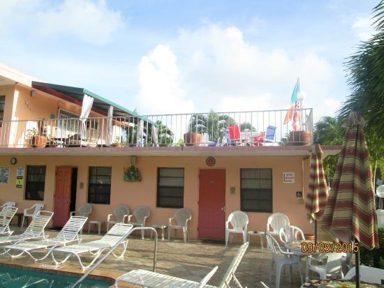 A Sea Garden Resort: pool area outside apartment