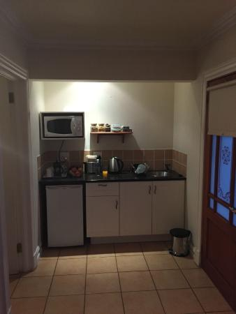 Seven Streams B&B: Kitchenette with Fridge - Microwave - Dishes etc: