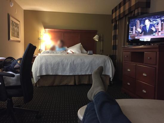 Hampton Inn & Suites Jackson : Large room with sofa, coffee table, desk, bed, dresser, tv