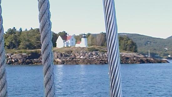 Schooner Lazy Jack II: View of a lighthouse from the Lazy Jack II
