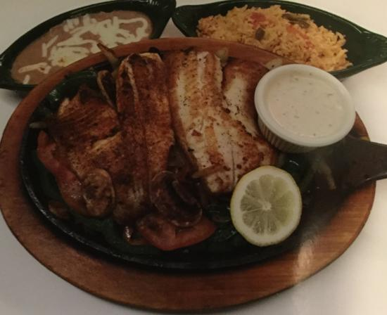 Cinco Amigos: Fajita Talapia sautéed with onions,bell peppers, tomatoes, rice, beans and tortillias!