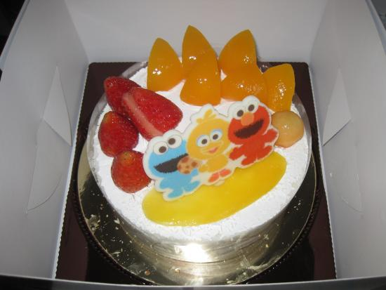 Wondrous Sesame Street Birthday Cake Picture Of Saint Honore Cake Shop Personalised Birthday Cards Petedlily Jamesorg