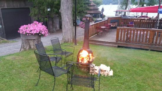 The Lake House: Fire pit on the lawn along the shore.