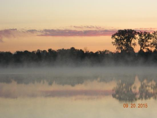 Goshen, IN: Steam rising off of the pond. Just before sunrise.