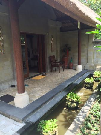 Samhita Garden: Villa entrance feeding the fish in the pond is fun too