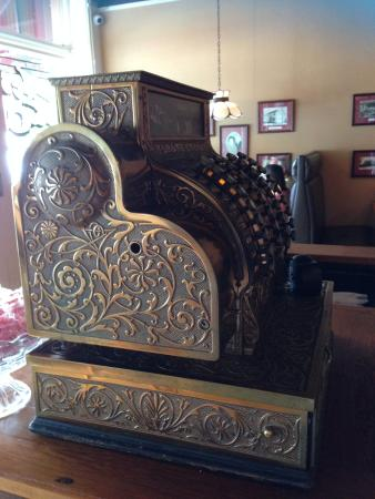 The Yesterday Cafe: Old brass cash register.
