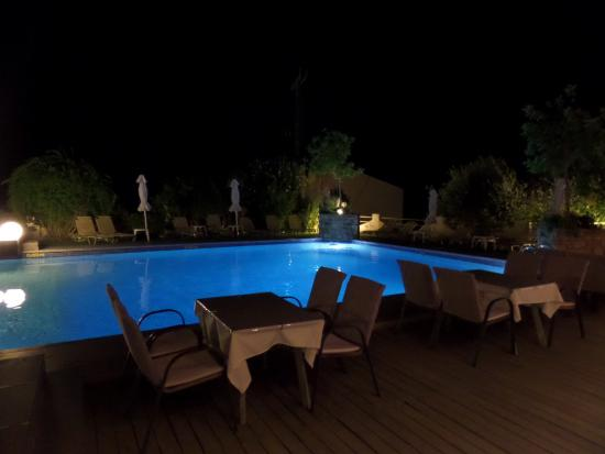 Enjoying a late night drink by the pool picture of sandy bay hotel agios isidoros for Late night swimming pools london