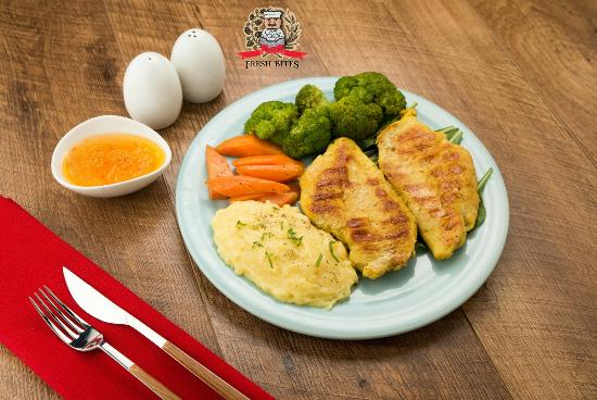2 Grilled Chicken Breast With Lemon Butter Sauce Served With 2
