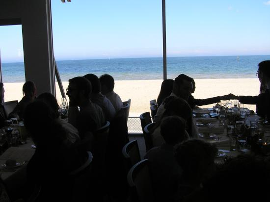 Sails on the Bay: View of beach from restaurant