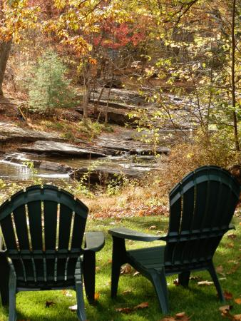 The Woodstock Inn on the Millstream: The Mill Stream in autumn from the lawn of the Inn