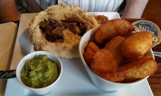 Clay Cross, UK: Steak & Ale Pie, Hand Cut Chips, Mushy Peas & A Jug Of Gravy - Crust Removed