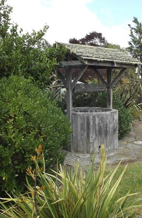 Lawn Cottages: Wishing well in grounds