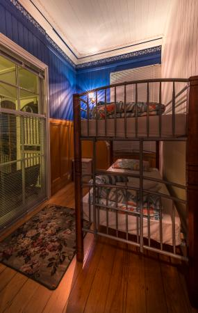 Minto Colonial Hostel: Budget Twin Room:  Room 2 is pictured, photographed at night.