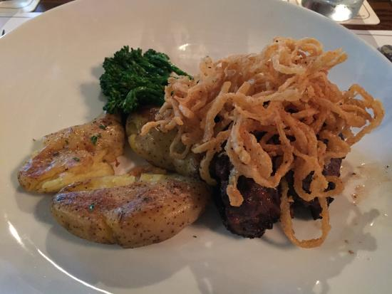 Manitowish Waters, WI: Filet mignon with onion strings, smashed fingerling potatoes and broccolini
