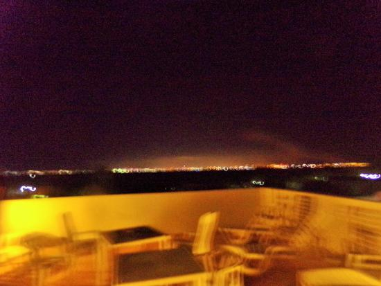 Hotel Kinich: Top deck view of Cancun lights in distance