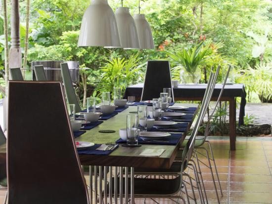The Garden House: Our dining table with view over the pool and field