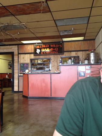 Hillbilly Willy's BBQ: Diner is located in a strip mall that has seen better days. Delicious bar-b-que! Order at the co