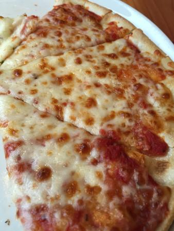 """Riva: This was supposed to be """"margarita pizza"""" - just a stale cheese pizza with no flavor"""