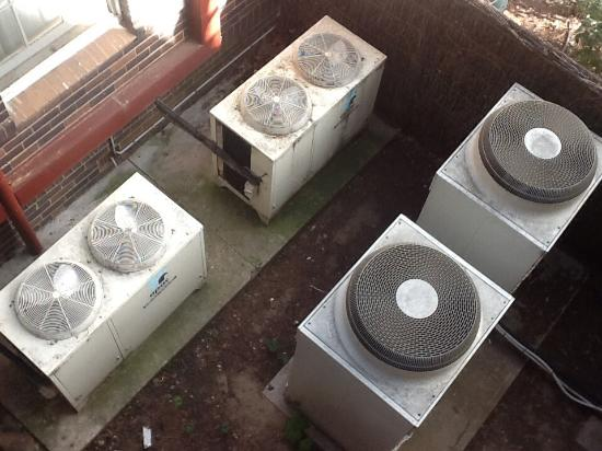 Brassey Hotel: The air conditioning units just outside the room