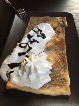 Chocolate filled crepe with fresh whipped cream