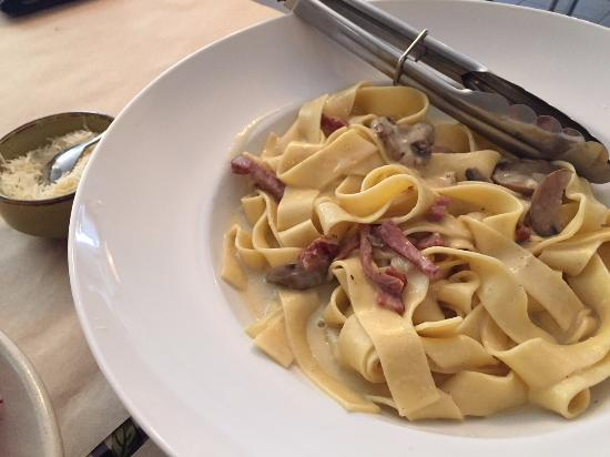 ... Fresh homemade pappardelle with a light bacon and mushroom cream sauce