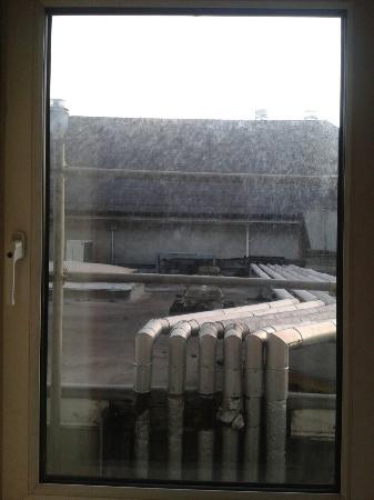 Newgrange Hotel: View from my room. Window looks like not cleaned in last 6 months, noisy fans underneath.