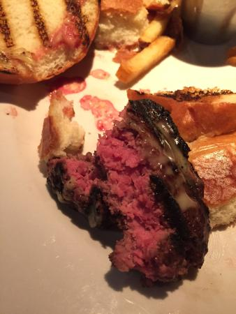 NECI on Main: Hamburger ordered medium. It came raw on the inside, and burned on the outside. Blood was drippe