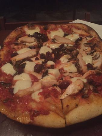 Maisy's: Best Brick Oven Pizza Ever! The Margherita Pizza.  I added mushrooms and chicken to it. Very del