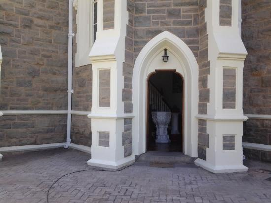 Dutch Reformed Church, Groot Kerk: Side entrance with baptismal font visible.