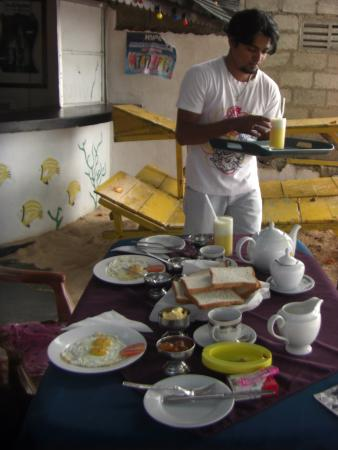 Seaview Deepal Villa: Our waiter prepares breakfast while we bathe