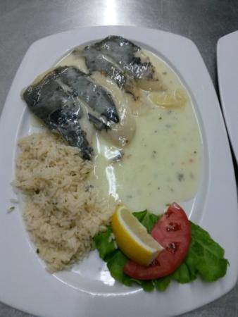 Poached fish fillet saint pierre in wine picture of for Poaching fish in wine